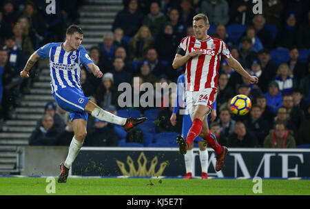 Shane Duffy of Brighton shoots as Darren Fletcher tries to intercept during the Premier League match between Brighton - Stock Photo