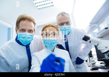 Happy researchers working in the lab - Stock Photo