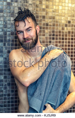 Handsome young man drying himself - Stock Photo