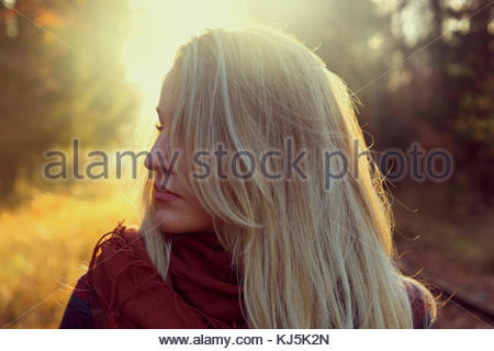 Closeup of young blonde woman. face side turned - Stock Photo