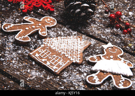 Christmas background. Gingerbread cookies laying on wooden table. - Stock Photo