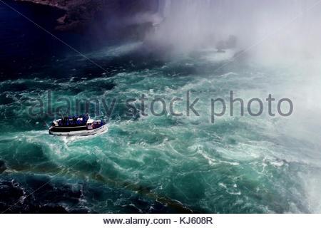 Tour boat by Niagra Falls - Stock Photo