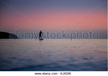 Standup paddle boarding on the Adriatic - Stock Photo