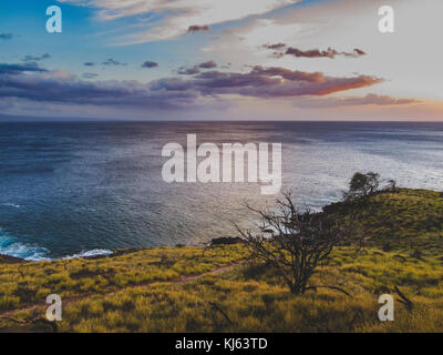 Stunning coastal sunset at Whale Lookout Point on the coast of Maui, Hawaii - Stock Photo