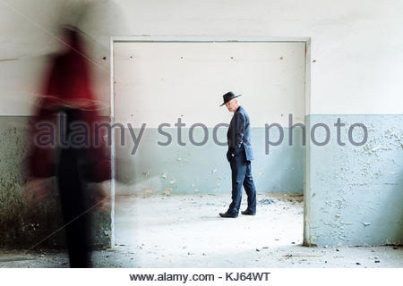 surreal man in hat blurred figure - Stock Photo