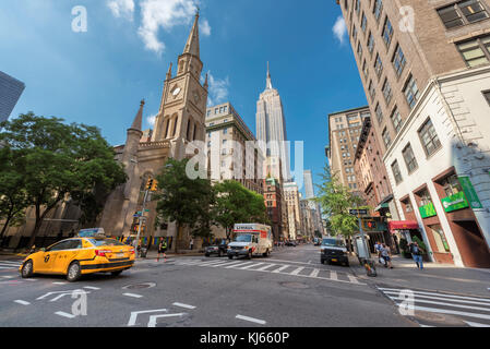 Fifth Avenue at summer day in New York City - Stock Photo