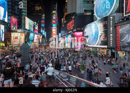 Times Square at night in Manhattan, New York - Stock Photo