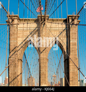 Brooklyn Bridge at sunset in New York - Stock Photo