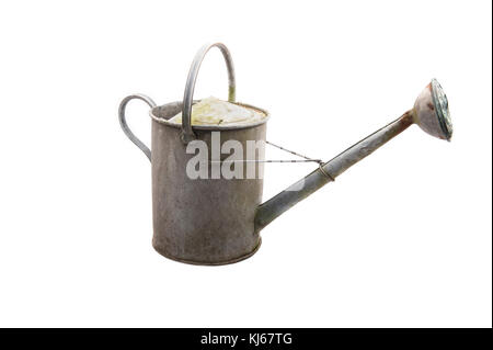 An old galvanized zinc watering can with rust isolated on white - Stock Photo