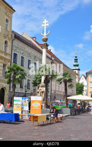 Klagenfurt, Austria - June 3, 2017: Alter Platz with Dreifaltigkeitssaeule (Holy Trinity Column) - Stock Photo