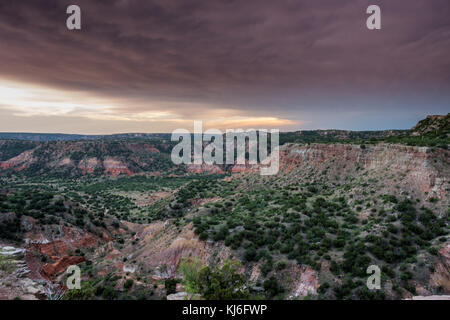 Storm Clouds and Sunset Over Palo Duro in west Texas - Stock Photo
