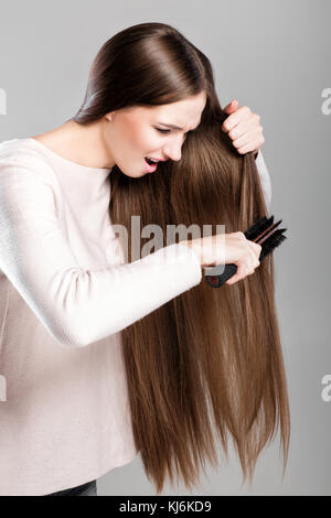 woman with  hairbrush - Stock Photo