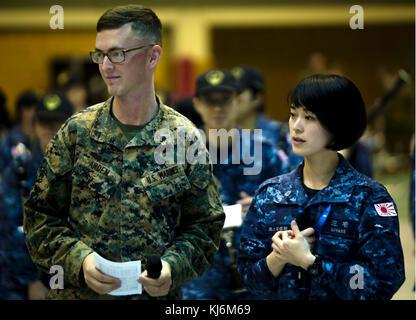 Japan Maritime Self-Defense Force Band member Yukari Miyake performs with U.S. Marine Cpl. Ivan Arden, a Chicago - Stock Photo
