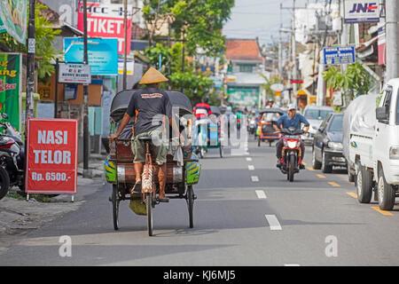 Cycle rickshaws / becak for public transport in the city Yogyakarta, Java, Indonesia