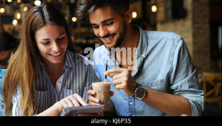 Woman and man flirting in cafe - Stock Photo