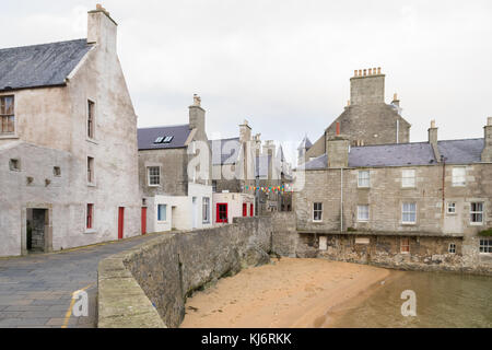 Lerwick Old Town, with the Queens Hotel formed from former lodberries adjoining Bains Beach, Lerwick, Shetland Islands, - Stock Photo