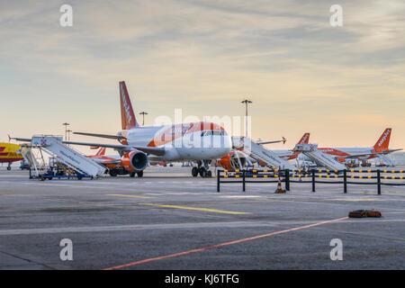 Milan Malpensa, Italy - November 21st, 2017: Row of Easyjet Airbus A320 airplanes on the tarmac at Milan Malpensa - Stock Photo