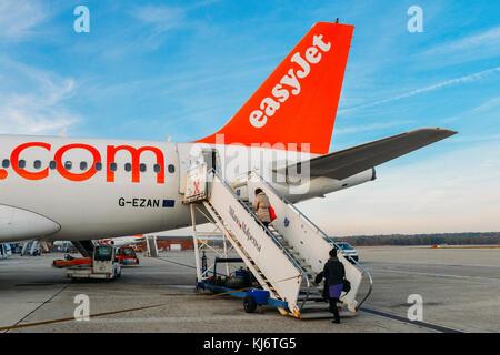 Milan Malpensa, Italy - November 21st, 2017: Passengers board an Easyjet Airbus A320 airplanes at Milan Malpensa - Stock Photo