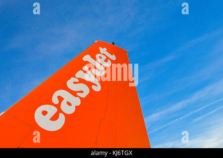 Milan Malpensa, Italy - November 21st, 2017:  Close up of  fin and tail of Airbus A320 airplane at Milan Malpensa - Stock Photo