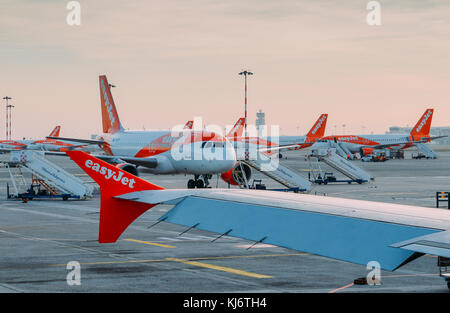 Milan Malpensa, Italy - November 21st, 2017:  Easyjet Airbus A320 airplanes at Milan Malpensa airport tarmac. Airliner - Stock Photo