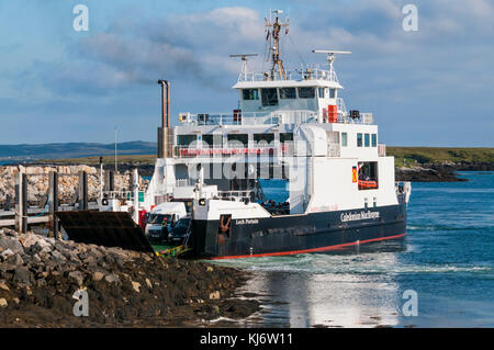 MV Loch Portain, the CalMac ferry between Berneray and Leverburgh on Harris at the Berneray ferry port. - Stock Photo