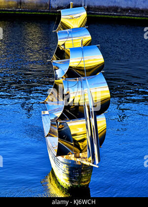 South Shields chrome steel metal sailing ship sculpture Fleet by Irene Brown in an old dry dock - Stock Photo