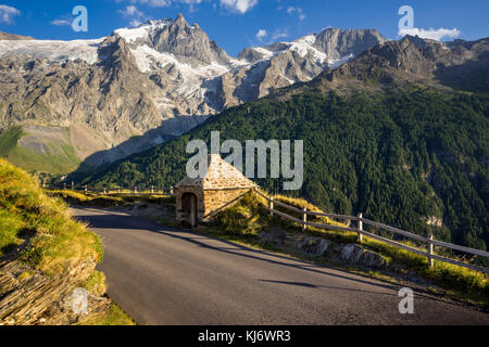 The Oratory of Le Chazelet at sunset with the peaks of La Meije and Rateau and their glaciers. Ecrins National Park, - Stock Photo