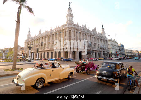 American cars in front of the Gran Teatro de La Habana Alicia Alonso Theatre, Paseo del Prado Street, Havana, Cuba - Stock Photo