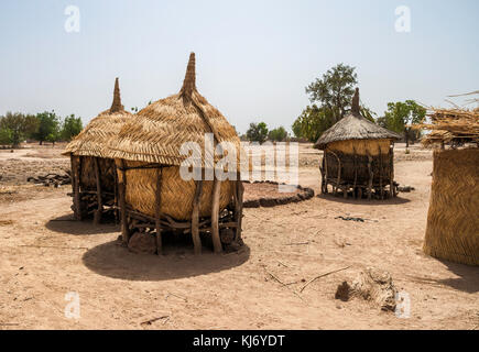 Three granaries used to store the crops in an mosi village of Burkina Faso. - Stock Photo