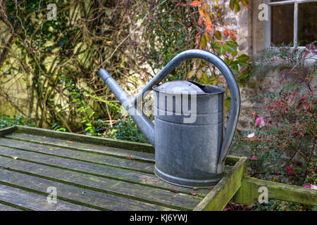 Old fashioned galvanized steel metal watering can - Stock Photo