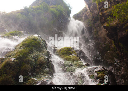 A waterfall along the dirty road to Manang in the Himalayan mountains, Marsyangdi valley. Nepal - Stock Photo