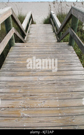 Wooden steps that leads out to the beach at Cocoa Beach, Florida. - Stock Photo