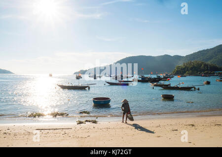 fishing boats off the beach on the Cham Islands in Vietnam - Stock Photo