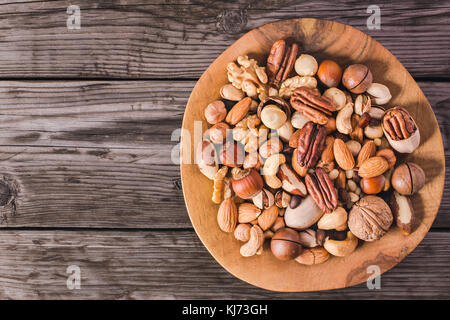 Nuts on plate above - Stock Photo