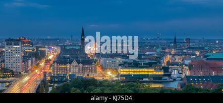 Evening in modern city, panorama of Copenhagen, Denmark - Stock Photo
