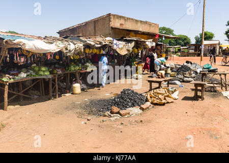 Small market with various stalls selling fruit and vegetables, Uganda, Africa - Stock Photo