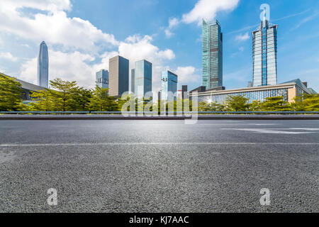 Panoramic skyline and buildings with empty road,chongqing city,china - Stock Photo