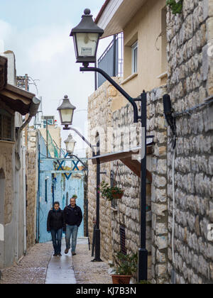Two men walking in street, Safed, Northern District, Israel - Stock Photo