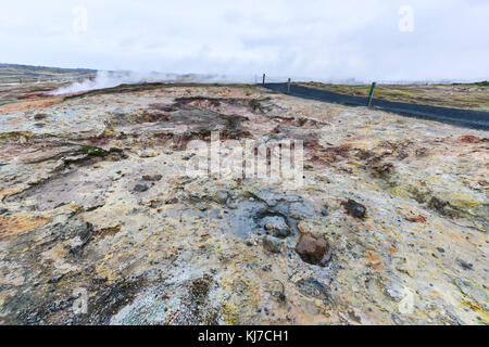Active volcanic zone at Gunnuhver geothermal area with Boiling water and steam emerging at Reykjanes Peninsula, - Stock Photo