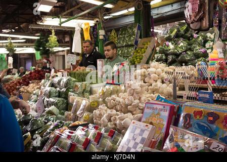 Merchandise for sale at market stall, Carmel Market, Tel Aviv, Israel - Stock Photo