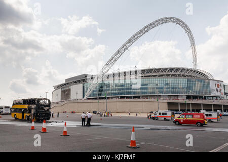 Supporters coach catches fire in a car park at Wembley Stadium, just before the Community Shield kick off. Saturday - Stock Photo