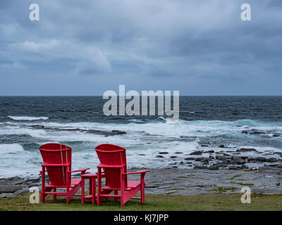 Two Red Chairs near Point Riche Lighthouse, Port au Choix National Historic Site, Highway 430, the Viking Trail, - Stock Photo