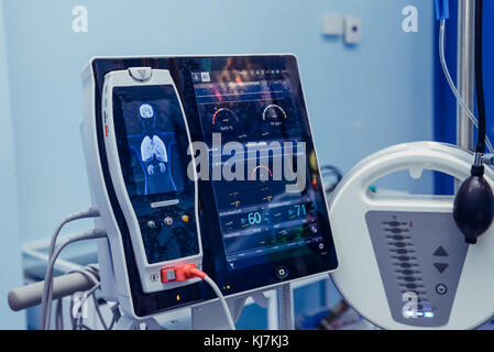Medicine, health care, emergency and medical equipment concept - extracorporeal life support machine at operating - Stock Photo