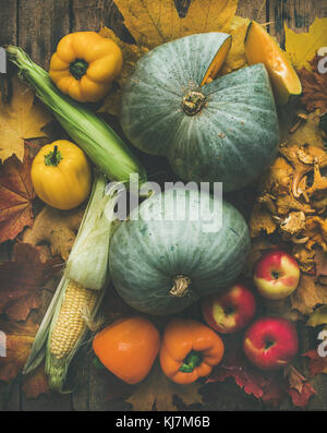 Fall colorful vegetables assortment over wooden table background, top view, vertical composition. Autumn food ingredient - Stock Photo