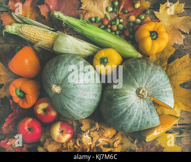 Fall vegetables assortment over wooden table background, top view. Autumn food ingredient background, pattern and - Stock Photo