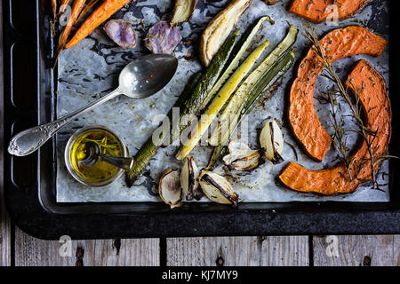 Roasted fresh vegetables on baking sheet. Top view - Stock Photo
