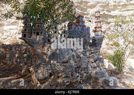 Memorial model of churches and religeous buildings in great detail, made from pebbles found on beach, near Archangelos, - Stock Photo