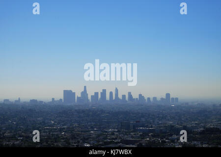 Los Angeles skyline view on a blue hazy morning with downtown city skyscrapers in the distance LA California USA - Stock Photo