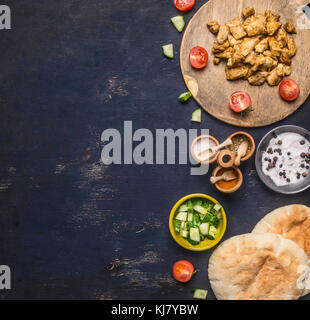Ingredients for cooking home-made shawarma, fried chicken with condiments, pita, sliced cucumbers, condiments and - Stock Photo