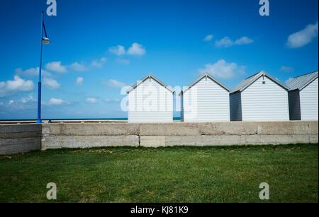 Small beach houses at the beach near Pourville-sur-mer, France - Stock Photo